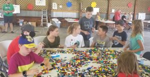 full-time kids play together with legos